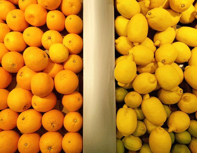It's a citrus day Food And Drink Full Frame Citrus Fruit Fruit Freshness Food Variation Market Multi Colored Orange Yellow EyeEm Gallery Photography Dubai United Arab Emirates EyeEm Lemon Sour Sweet Division Separation Left Right