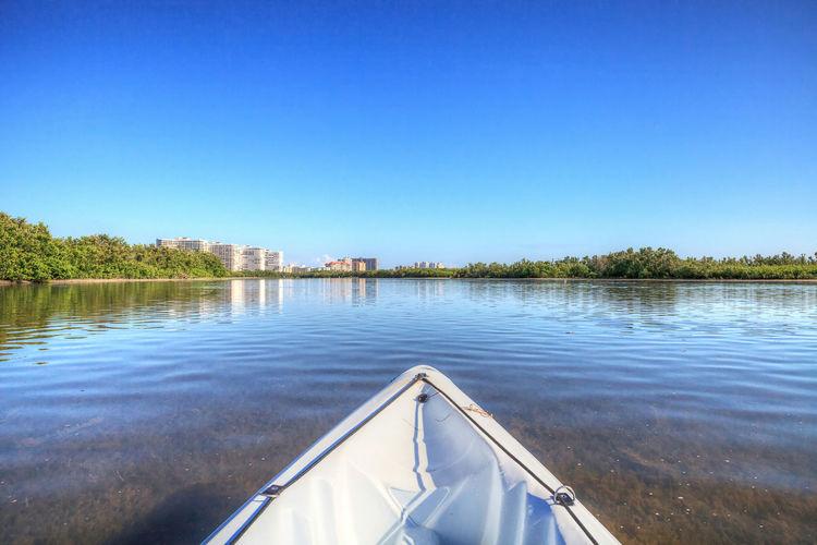 Kayak glides through water along the coastline of marco island, florida near tigertail beach.
