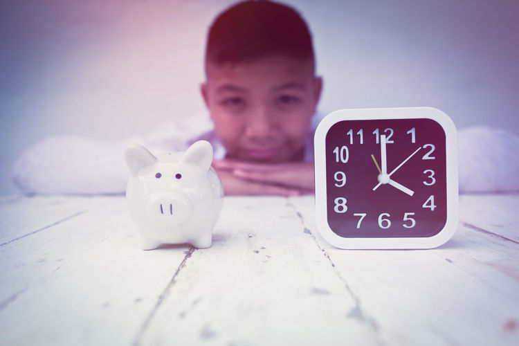 Adult Clock Communication Day Indoors  One Person People Piggy Bank Text Time