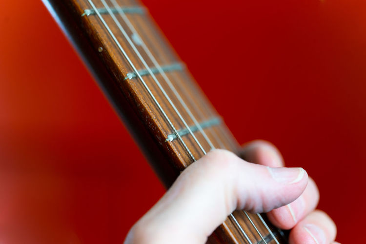 Premium Collection The Premium Collection Hand Music Finger Plucking An Instrument String Playing Guitar Musical Equipment Colored Background String Instrument Musical Instrument Arts Culture And Entertainment Human Hand Artist Musician Close-up
