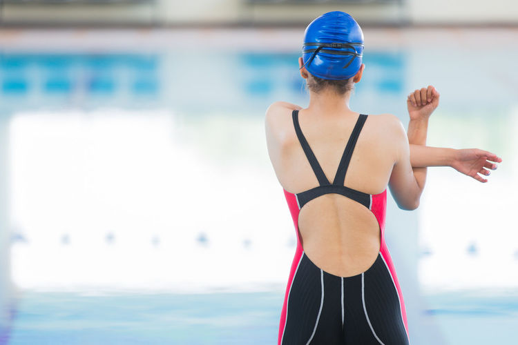 Adult Clothing Day Exercising Focus On Foreground Hairstyle Healthy Lifestyle Leisure Activity Lifestyles One Person Real People Sea Sport Standing Swimming Cap Swimming Pool Swimwear Water Women