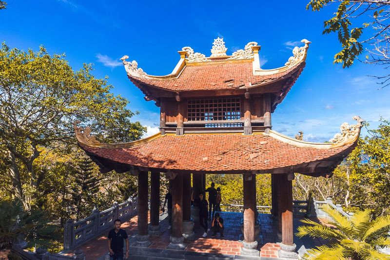 Temple by building against sky