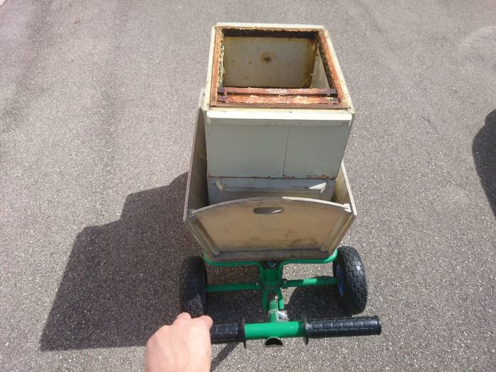 Empty beehive on a wheelbarrow