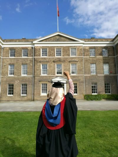 Rear view of woman in graduation gown at university of leicester