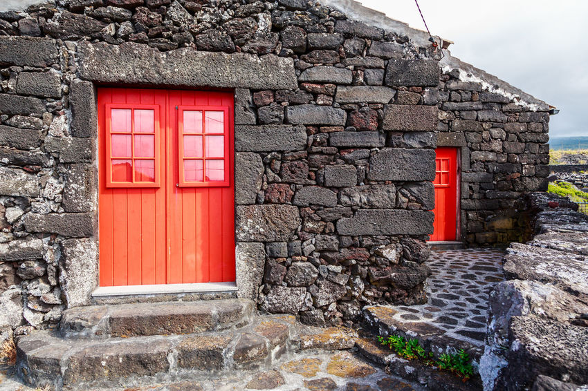 Azores Pico Island Architecture Basaltic Rock Brick Building Building Exterior Built Structure Closed Day Door Entrance House Nature No People Outdoors Red Residential District Solid Stone Wall Tipical House Wall Wall - Building Feature Water Window