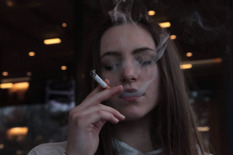 Close-Up Of Young Woman Smoking Cigarette