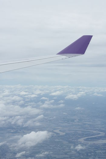 Shot from an thai airways Airplane. Air Shot Air Vehicle Airline Airplane Airplane Wing Backpack Backpackers Cloud - Sky Clouds And Sky Day Flugzeug Flying Mid Flight Mid-air Nature No People River Sky Thai Airways Thailand Transportation Travel