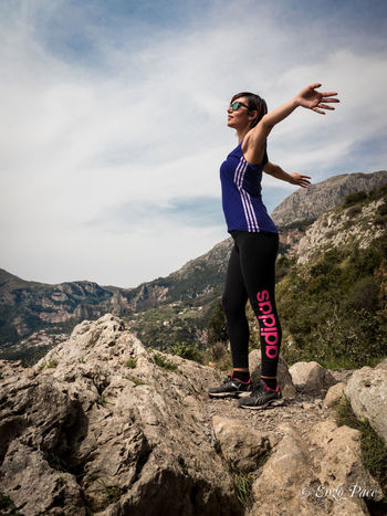 Sentiero degli Dei Beauty In Nature Casual Clothing Cloud - Sky Day Full Length Happiness Leisure Activity Lifestyles Mid Adult Women Mountain Nature One Person Outdoors People Real People Rock - Object Scenics Sky Smiling Standing Sunglasses Young Adult Young Women First Eyeem Photo