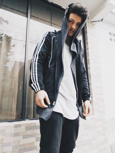 EyeEm Selects Young Adult Young Men Casual Clothing One Person Standing Leisure Activity Fashion Real People Lifestyles Front View One Young Man Only Men Day Built Structure Outdoors Architecture Building Exterior Fashion Model Portrait City