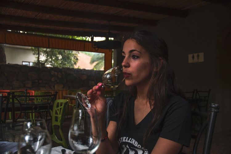 Tasting wine One Person Indoors  Real People Food And Drink Young Adult Side View Drink Lifestyles Young Women Headshot Wine Wineglass One Woman Only Food Only Women Day One Young Woman Only Adult Adults Only People