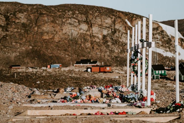 Graveyard against mountain