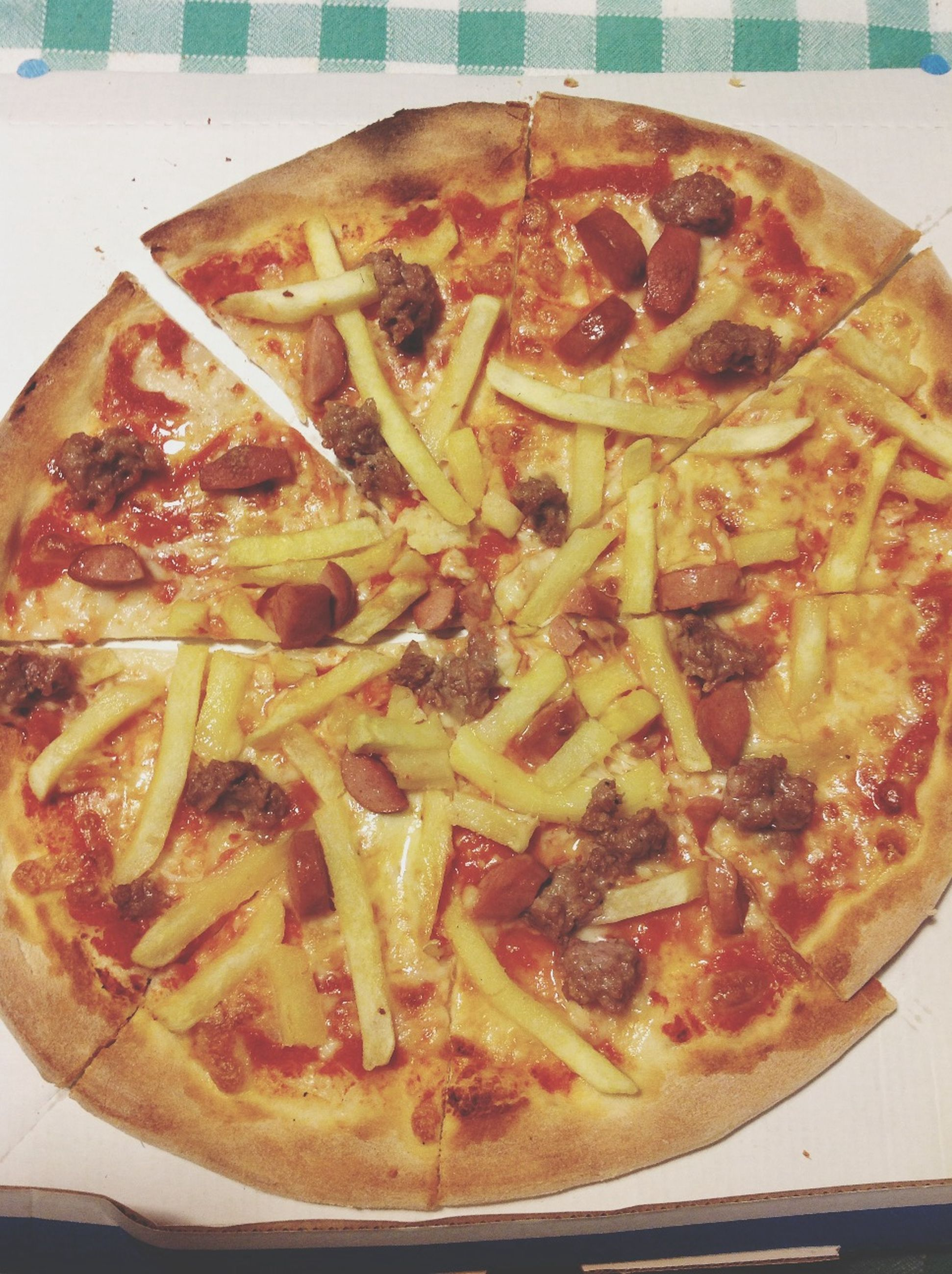 food, food and drink, indoors, freshness, ready-to-eat, pizza, still life, unhealthy eating, plate, close-up, indulgence, table, high angle view, cheese, meal, snack, serving size, slice, directly above
