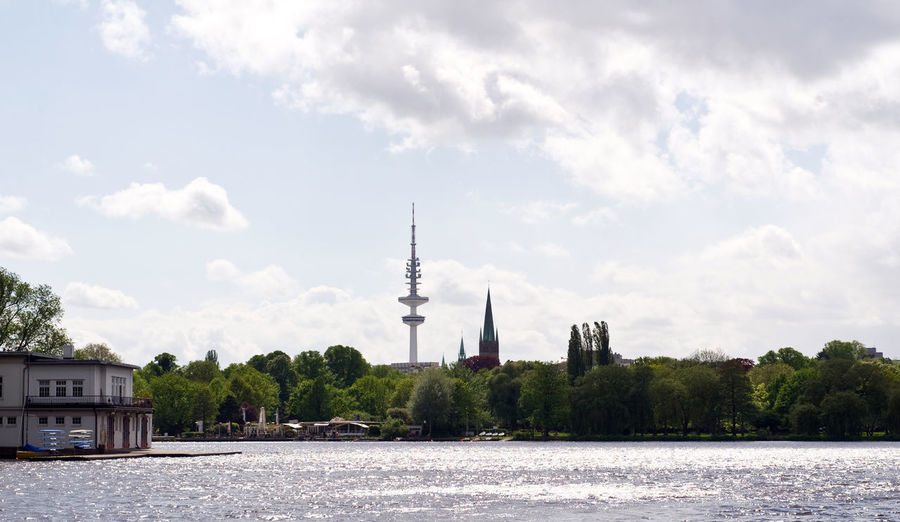 Alster Hamburg TV Tower Architecture Building Building Exterior Built Structure City Waterfall Cloud - Sky Communication Day Global Communications Nature No People Outdoors Plant Sky Spire  Tall - High Tourism Tower Travel Travel Destinations Tree Water