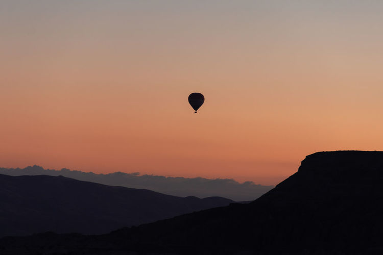 World best hot air balloon destination. Goreme, Turkey. Cappadocia Turkey Sunset Sky Beauty In Nature Scenics - Nature Silhouette Mountain Orange Color Air Vehicle Hot Air Balloon Tranquil Scene Balloon Tranquility Nature Mid-air Flying Non-urban Scene Idyllic Transportation Environment Mountain Range No People Mountain Peak