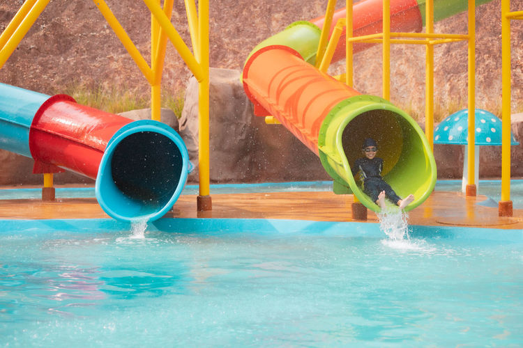Close-up of multi colored drinking water in swimming pool