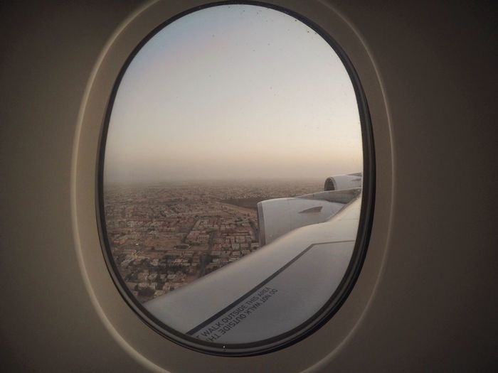 Going south-east Airplane Transportation Glass - Material Air Vehicle Flying Window Travel Vehicle Interior Aerial View Landscape Sky Journey Mid-air Town Emirates Dubai Airbus A380 Turbine Wing Desert Town Desert Window View Likeabird