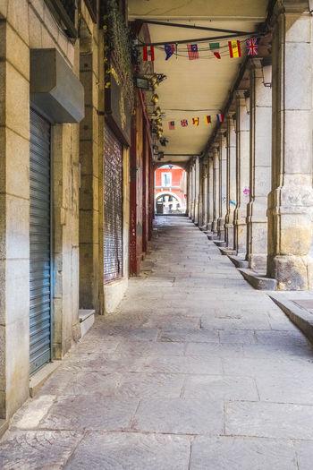 Empty corridor along buildings