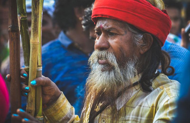 Close-up of senior man holding sticks
