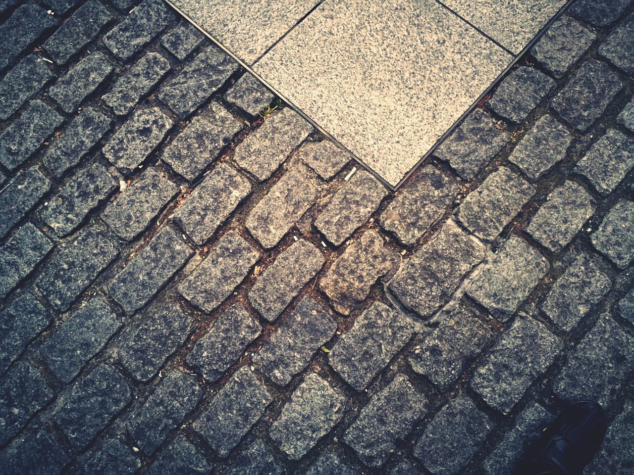 pattern, backgrounds, street, full frame, footpath, high angle view, no people, cobblestone, stone, textured, paving stone, day, sidewalk, geometric shape, city, stone material, outdoors, design, shape, transportation