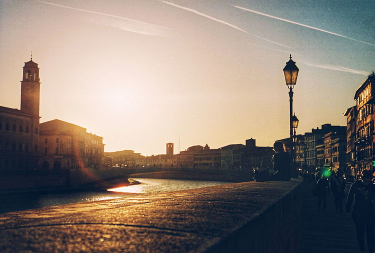 Sunset over the River Arno in Pisa - Film Film Photography Street Photography Streetphotography Sunset Dusk Sunset_collection Nikon F3 Travel Travel Photography Grain Lens Flare The Street Photographer - 2016 EyeEm Awards