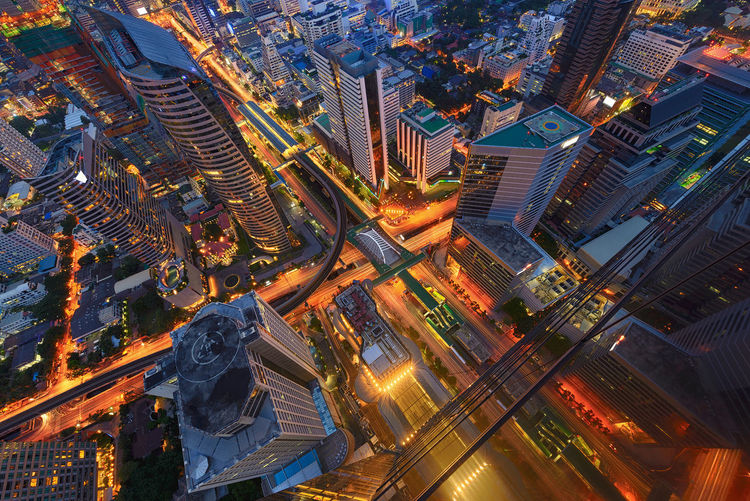 Sathorn Intersection, Bangkok, Thailand Bangkok Cityscape Downtown Financial District  Intersection Thailand Aerial View Architecture Building Exterior Buildings Built Structure Chong Nonsi City City Life Cityscape Downtown District High Angle View Illuminated Modern Night No People Outdoors Road Sky Skyscraper Travel Destinations Urban Skyline