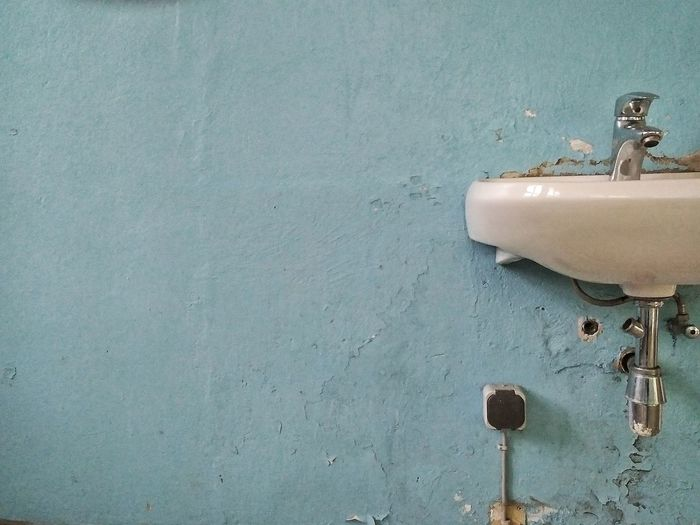 Sink attached to blue wall