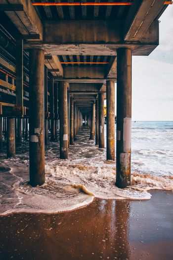 Beach tunnel Built Structure Architecture Architectural Column Water Sea Beach Underneath No People Pier Nature Day Land Bridge Below Connection Bridge - Man Made Structure Outdoors In A Row Sunlight Colonnade