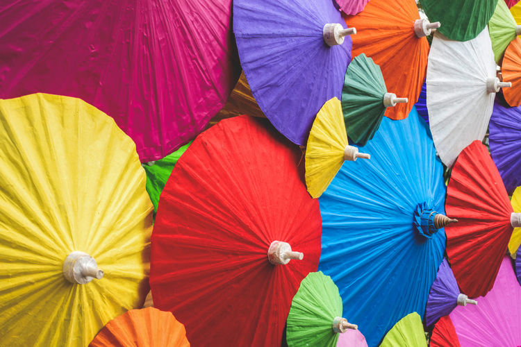 Colorful traditional Asian paper umbrellas Multi Colored Umbrella Backgrounds Variation Pattern Outdoors Asian  Artworks Paperwork Traditional Backdrop