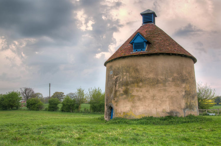 Kinwarton Dovecote. Abandoned Architecture Barn Beauty In Nature Building Exterior Built Structure Cloud - Sky Damaged Day Dovecote Dovecote Kinwarton, Warwickshire UK Field Grass National Trust 🇬🇧 Nature No People Old Outdoors Sky Tree Weathered