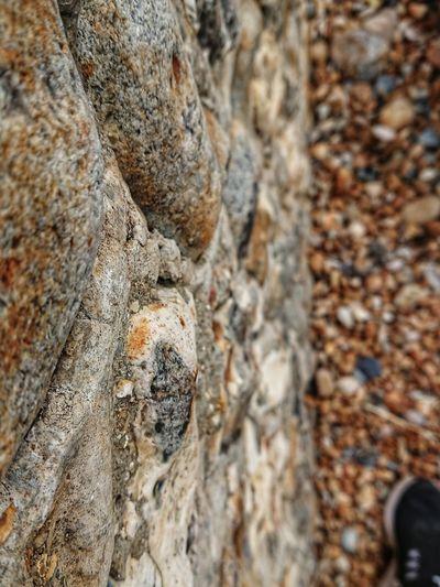 Sea wall Wall Sea Wall Sea Defence Pebbles Foot Rock - Object Textured  Full Frame Close-up