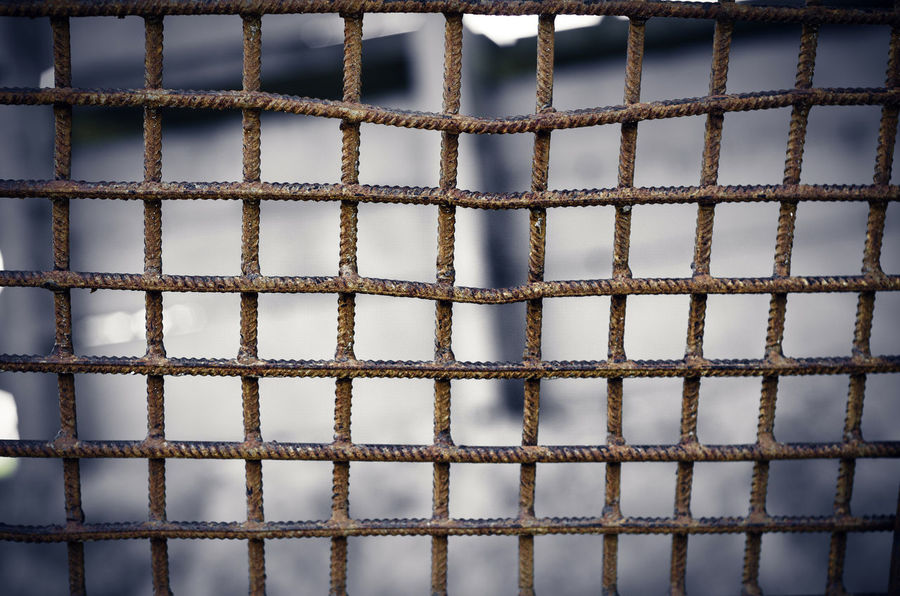 Metal lattice welded from reinforcement Backgrounds Brown Built Structure Close-up Day Design Full Frame In A Row Indoors  Metal No People Old Pattern Repetition Rusty Shape Textured  Wall - Building Feature White Color