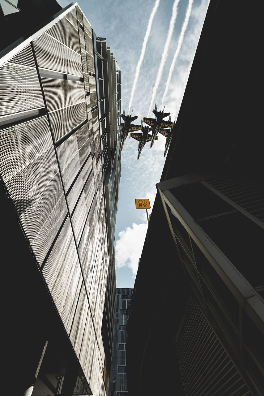 built structure, building exterior, architecture, sky, cloud - sky, nature, low angle view, building, city, day, no people, outdoors, transportation, sunlight, mode of transportation, water, reflection, glass - material, sea, office building exterior, digital composite