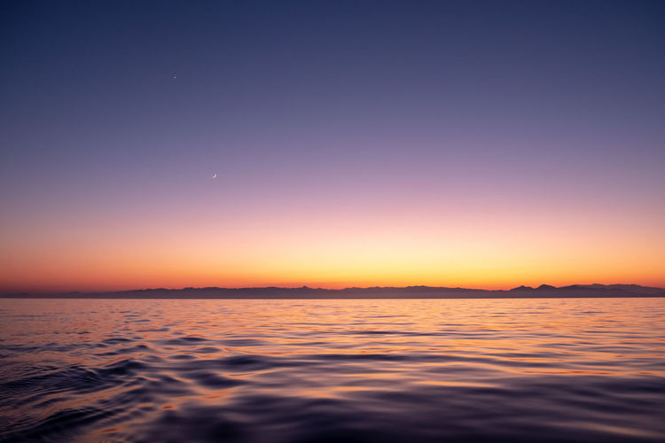 Beauty In Nature Clear Sky Horizon Idyllic Moon Nature Night No People Orange Color Outdoors Scenics - Nature Sea Sky Sunset Tranquil Scene Tranquility Water