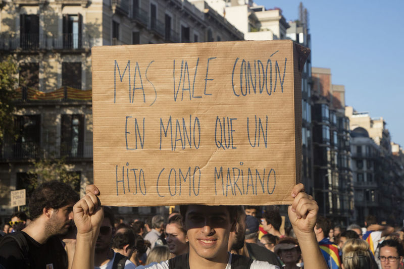 """Barcelona, Spain - October 3, 2017. Demonstrators bearing placards during protests for independence in Barcelona, Catalonia, Spain. On that banner is said: """"better is having a condom than a son like Mariano Rajoy (president of Spain)"""" Barcelona Catalonia Catalonia Is Not Spain Democracy Freedom Independence Independencia Politics Protest Protest Signs Protests Rights Challenge Crowd Democratic Independent  March Political Politics And Government Protesters Protesting Protestor Protestors Riot Riots"""