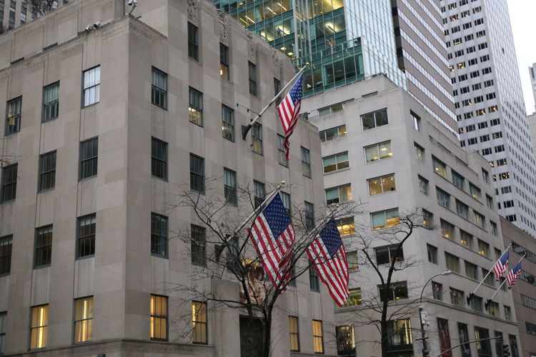 US American Flags Architecture Building Exterior City Built Structure Building Outdoors US American Flags Flags Flags In The Wind  NYC Street Photography