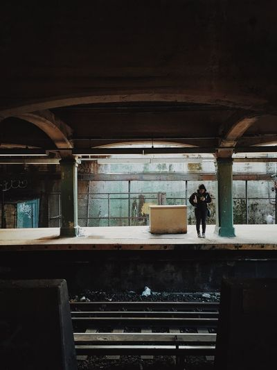 Person Standing At Railroad Station Platform