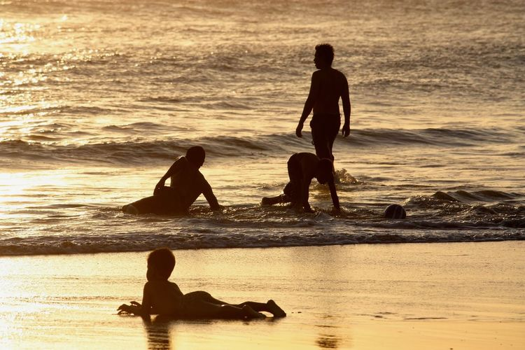 Bali Evening Fun INDONESIA Seminyak Beach The Street Photographer - 2018 EyeEm Awards Beach Leisure Activity Lifestyles Outdoors Real People Sea Silhouette Sunset Water