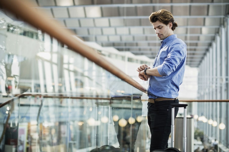 Full length of young man looking at camera