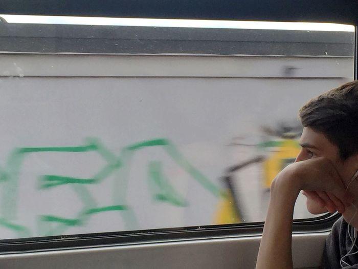 Close-up of man seen through train window