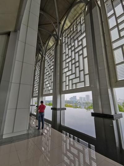 Rear view of man walking in modern building