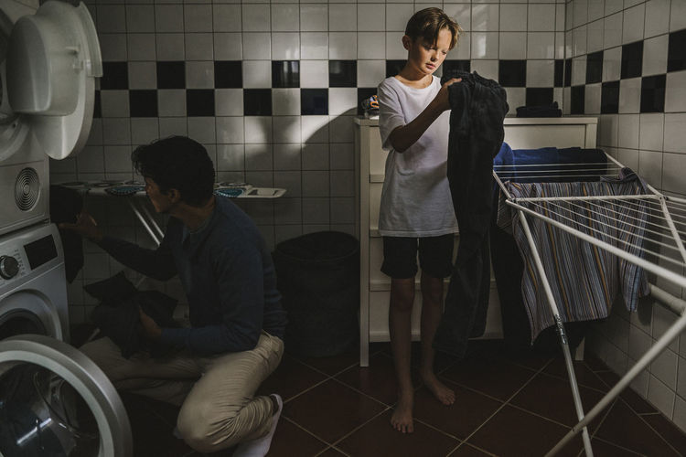 Young men sitting in bathroom