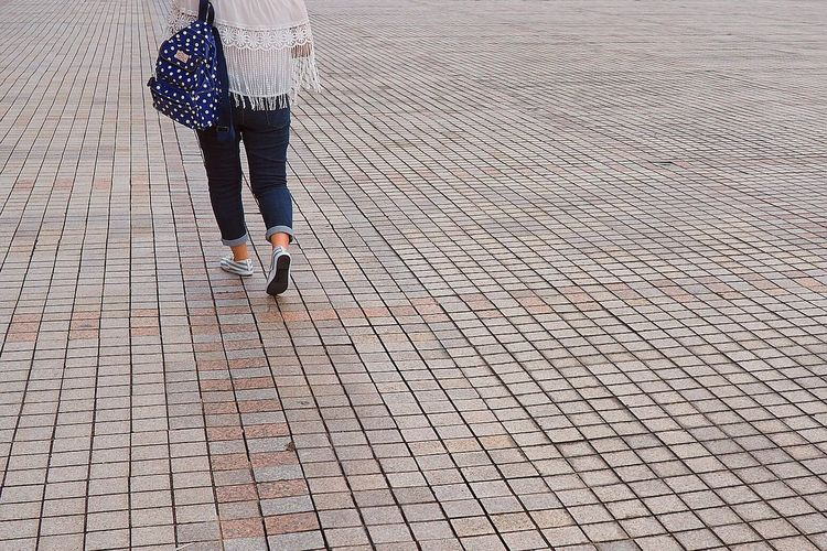Close-Up Of Woman Walking On Street