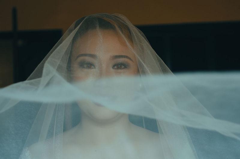 Portrait of beautiful woman wearing veil