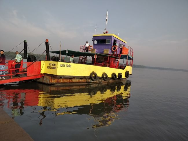 Water Nautical Vessel Mode Of Transportation Transportation Sky Waterfront Sea Reflection Nature Real People Day Men Travel Outdoors Group Of People People Cloud - Sky Occupation Yellow Fishing Boat