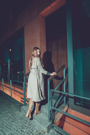 Full Length Real People Architecture Lifestyles Women Standing Night Leisure Activity Built Structure Two People People Togetherness Building Exterior Casual Clothing Young Adult Adult Railing Rear View Clothing Outdoors Warm Clothing Hairstyle