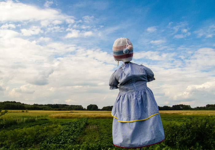 Beautiful Scarecrow on the Field. 2016 Beautiful Blue Color Blue Sky Casual Clothing Clouds Cute Day Dress Field Field Hanging Out Hat Knit Hat Meadow Non-urban Scene Plain Protection Rear View Rural Scene Scarecrow Scenics Tranquil Scene