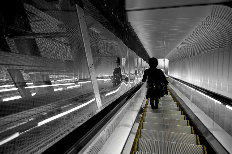 High angle view of person on escalator