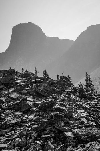 hikers size of ants scalling the mountains Water Blackandwhite Monochrome Country Hill Climbers Hiking Outdoors Mountain Fog Sky Landscape Snowcapped Mountain Range Rocky Mountains
