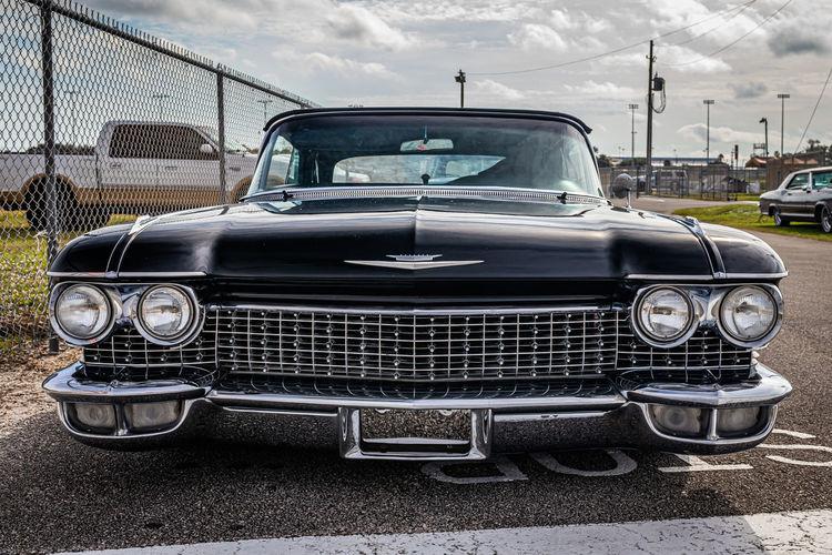 Vintage car against cloudy sky