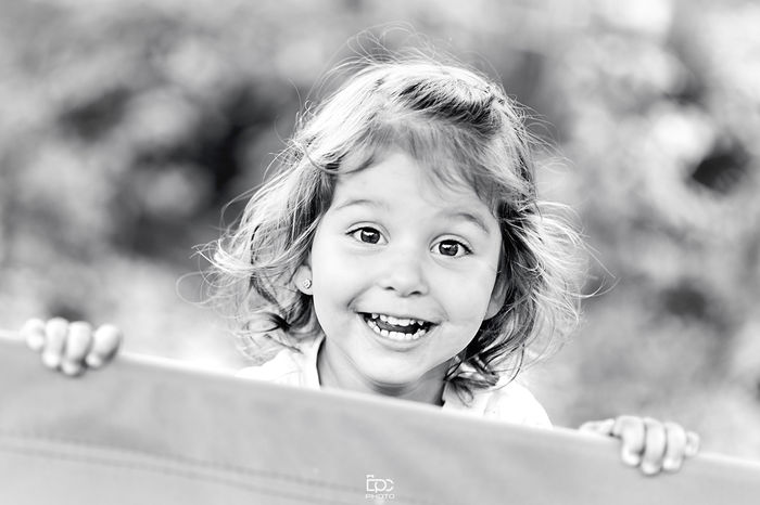 Blackandwhite Smile Sommer Portrait Looking At Camera Child Children Only Childhood One Girl Only One Person Front View People Headshot Desaturated Outdoors Cheerful Smiling Day